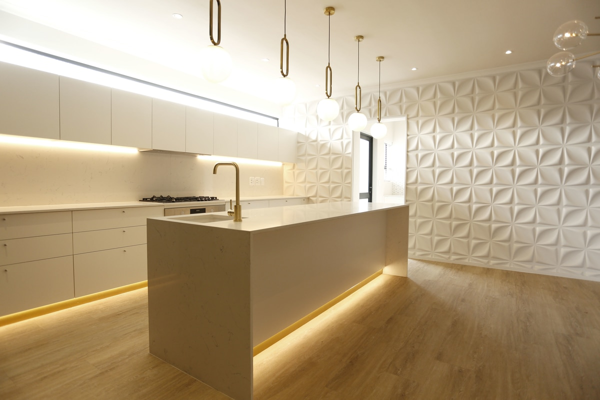 modern contemporary kitchen waterfall island pendent lights feature wall