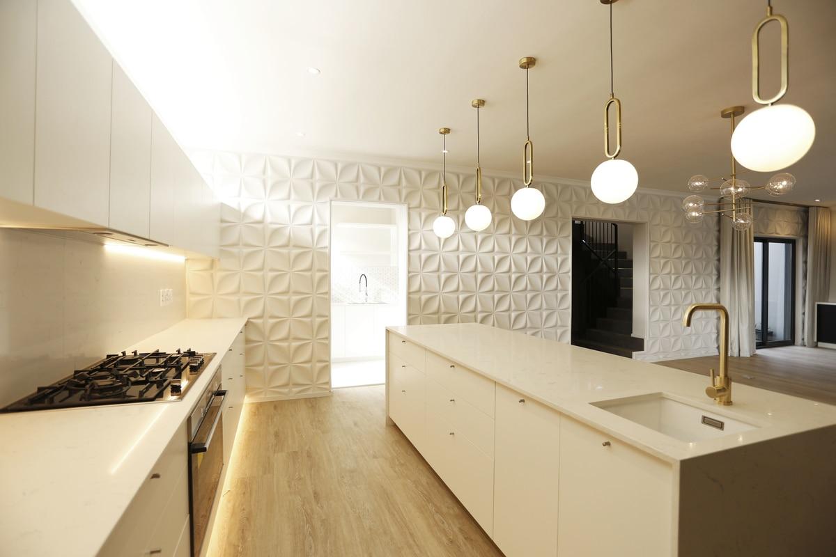 modern kitchen gold tap gas stove hanging lights