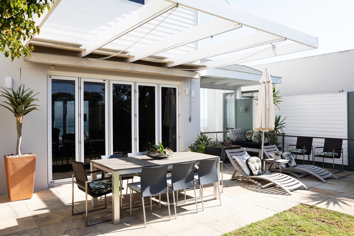 outdoor living dining table sun loungers