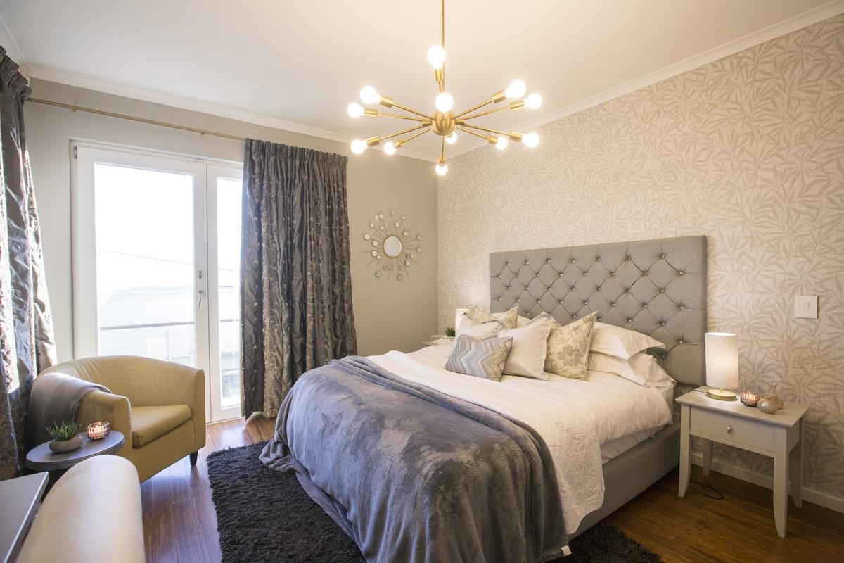 vintage bedroom grey headboard pendent light