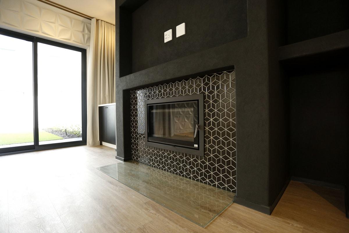 warm fireplace black patterned tiles