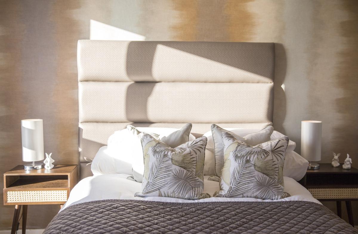 warm vintage bedroom cream headboard