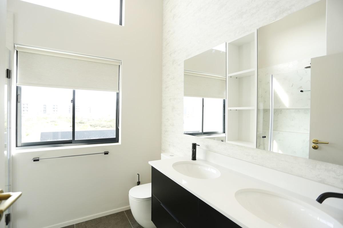 white bathroom open shelves