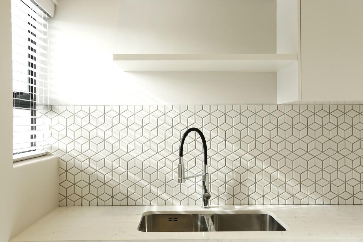 white scullery basin tap silver