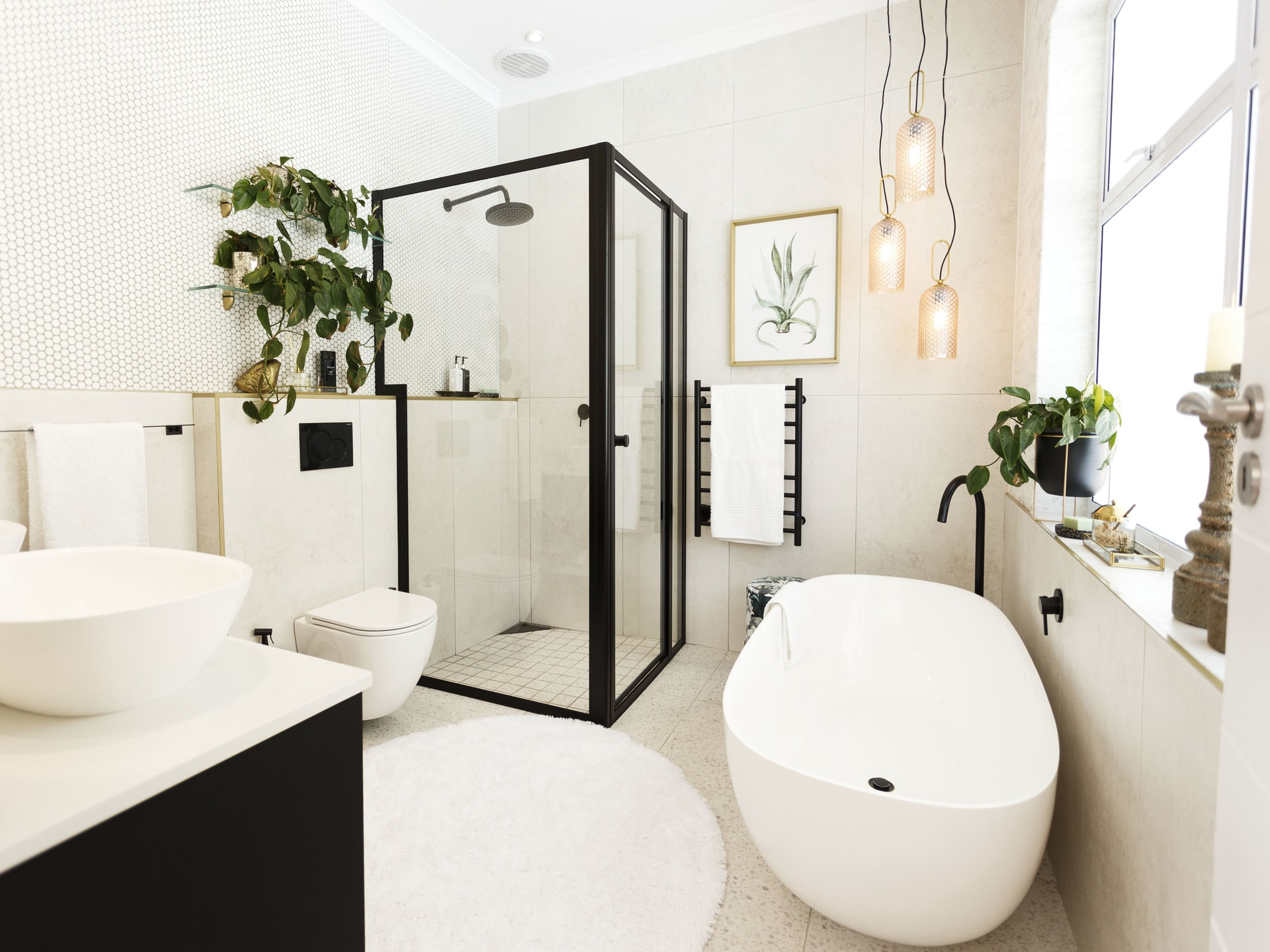 Modern bathroom renovation matte black gold white