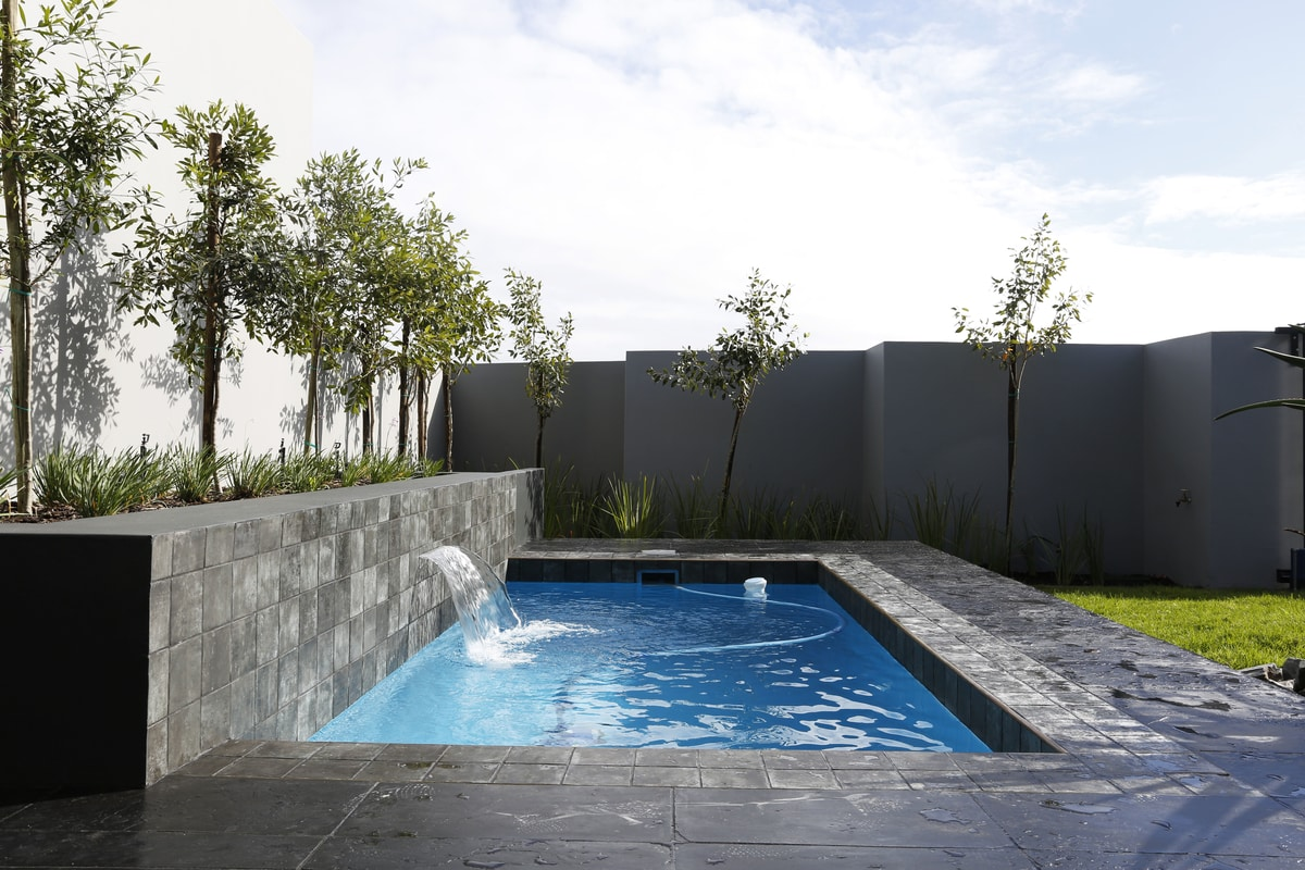 black swimming pool modern outdoor area with water fountain