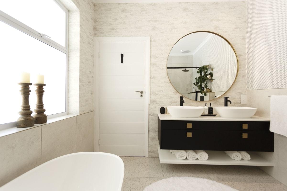 modern bathroom floating black gold vanity
