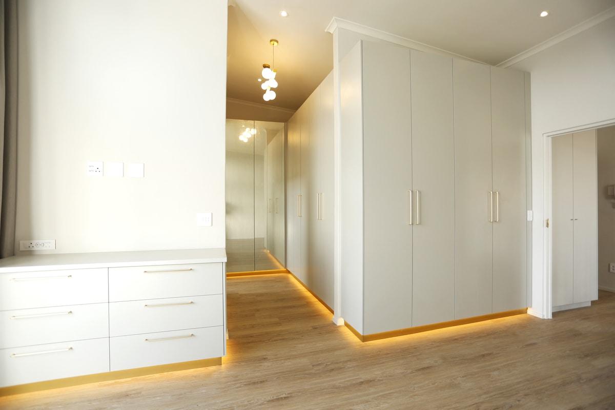 modern master bedroom cupboards led lighting