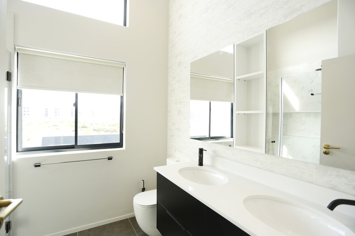 monochrome bathroom black vanity custom cupboards