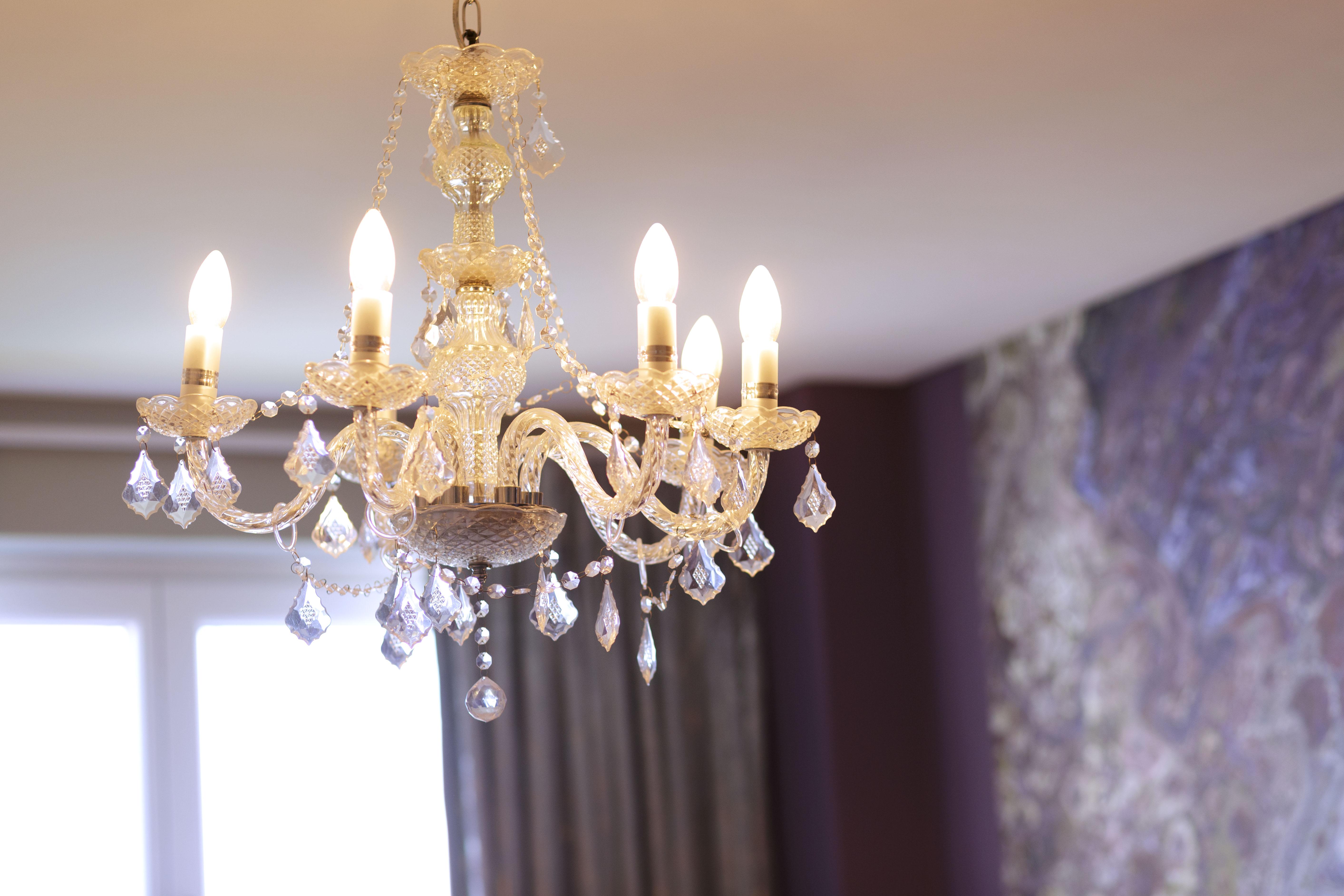 crystal chandelier in gemstone themed bedroom