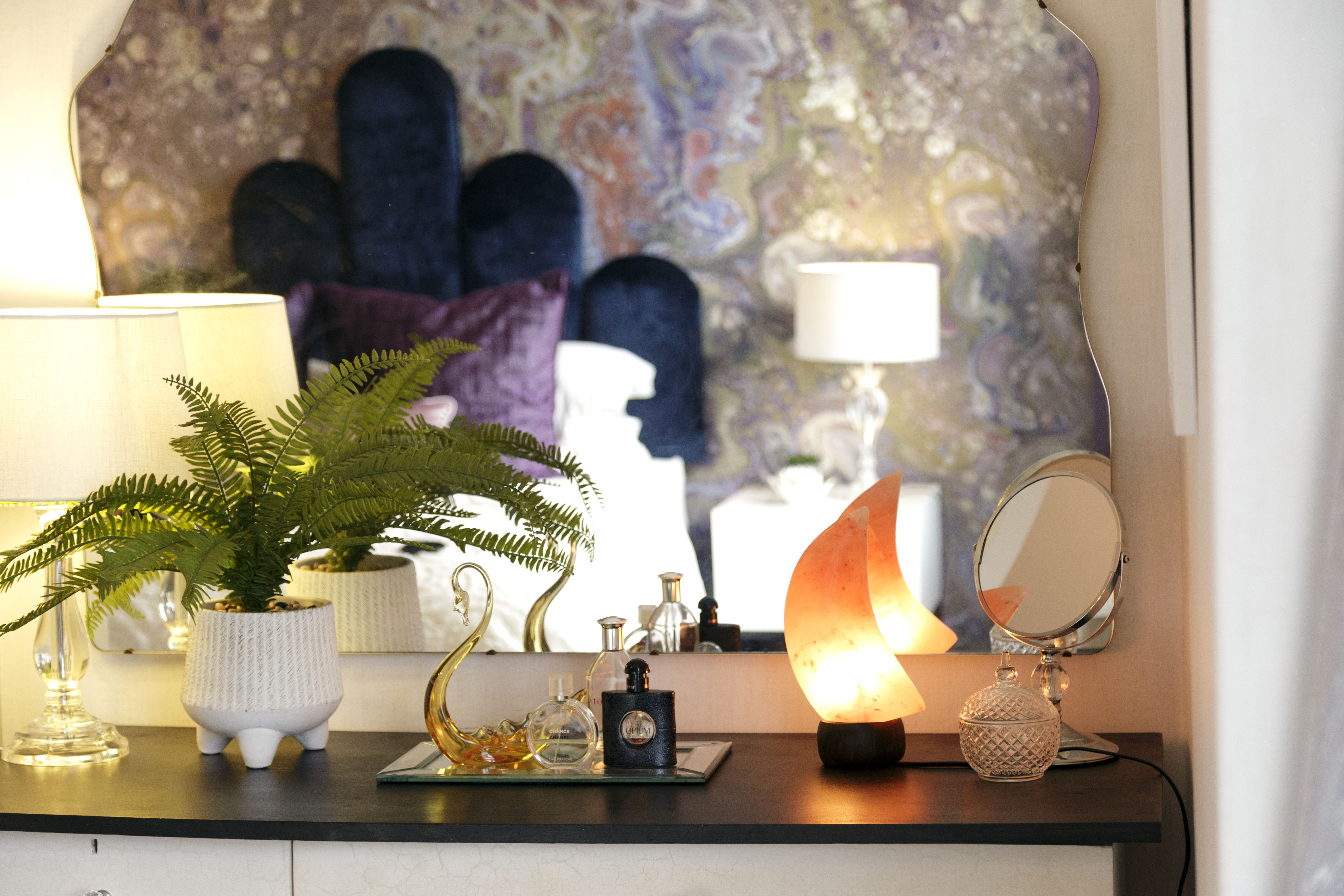 dressing table interior decor with mood salt lamp, plant and purfume disp;ay