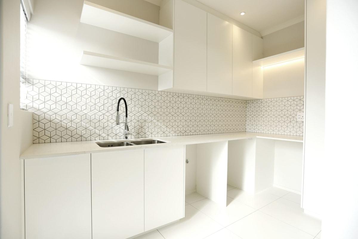 white scullery kitchen silver tap basin