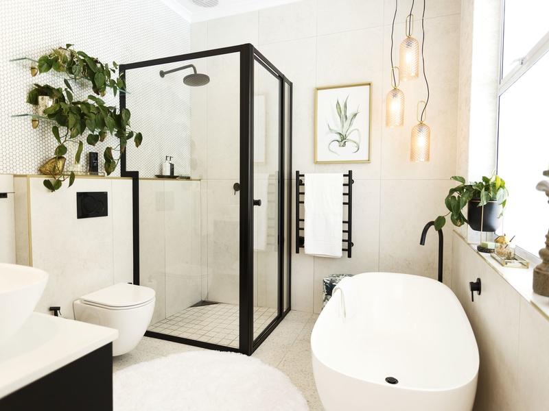 white modern bathroom black bathroom tapware accessories indoor plants